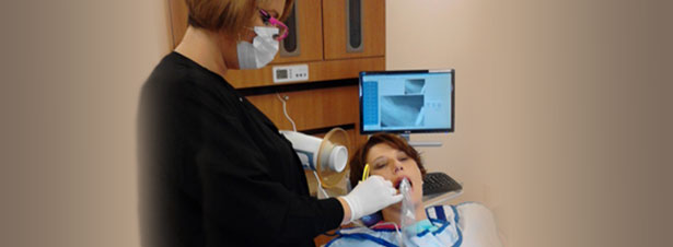 Photo of dental hygienist from Foundry Rescue Mission and Recovery Center giving a patient a digital radiograph