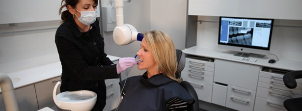 Photo of dental hygienist from Dr. Neal Patel, DDS, taking a digital radiograph on a patient